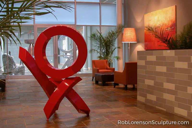 red abstract sculpture in a foyer