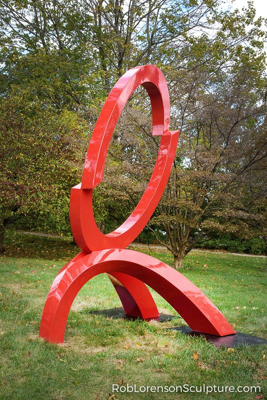 red painted large-scale abstract public landscape sculpture