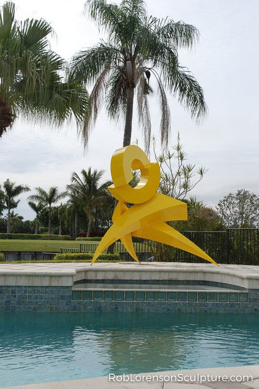 outdoor yellow abstract metal sculpture
