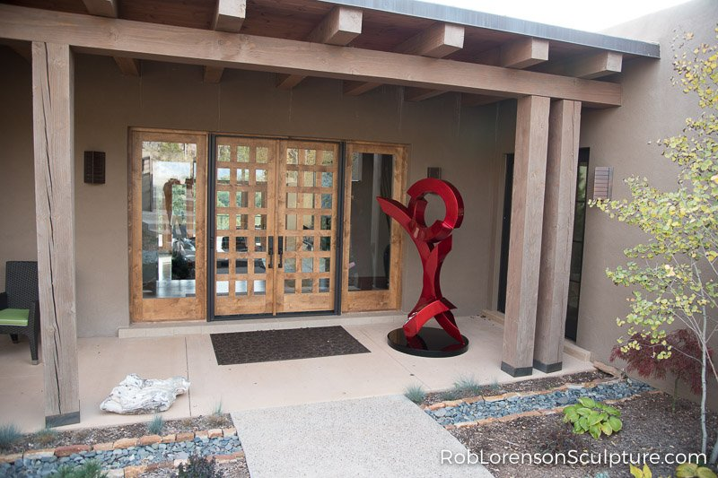 red metal sculpture in a house courtyard