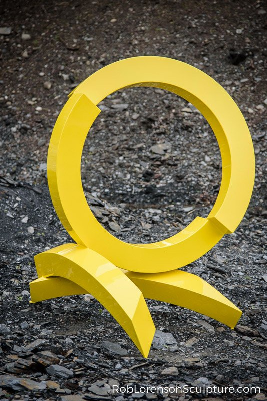 yellow mid-scale metal abstract sculpture