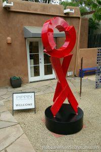 red outdoor metal sculpture