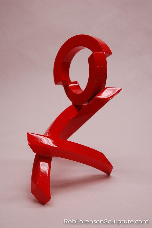 small red indoor metal sculpture