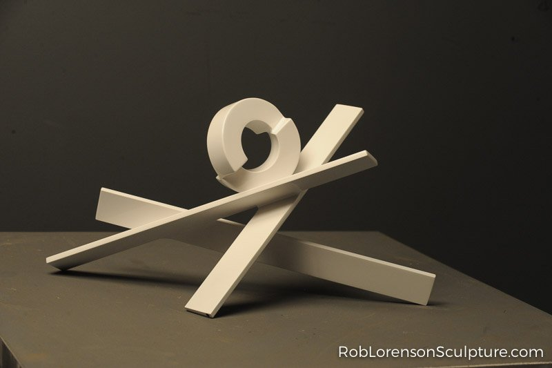 white abstract outdoor metal sculpture