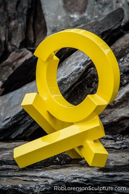 yellow metal outdoor sculpture