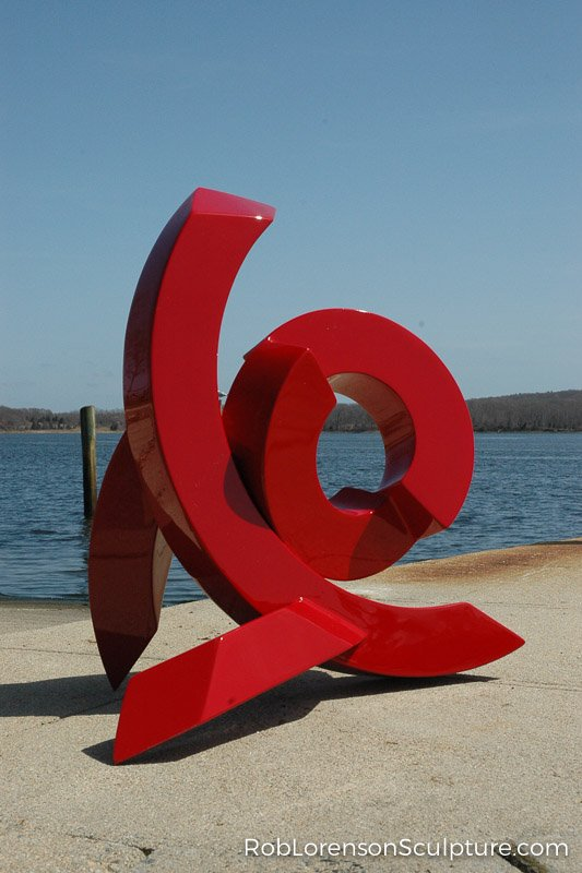 red small outdoor metal sculpture