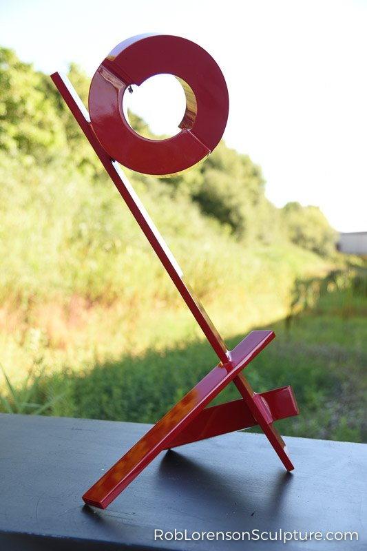 red small scale indoor sculpture
