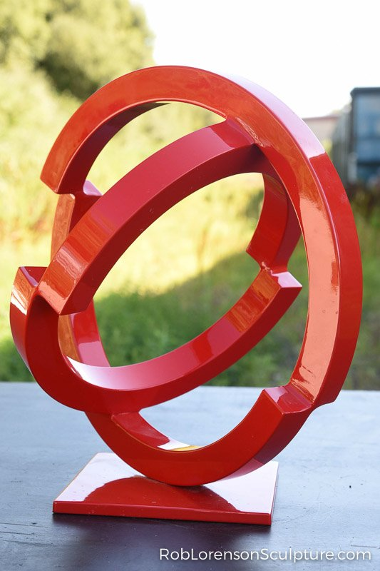 small red indoor abstract metal sculpture