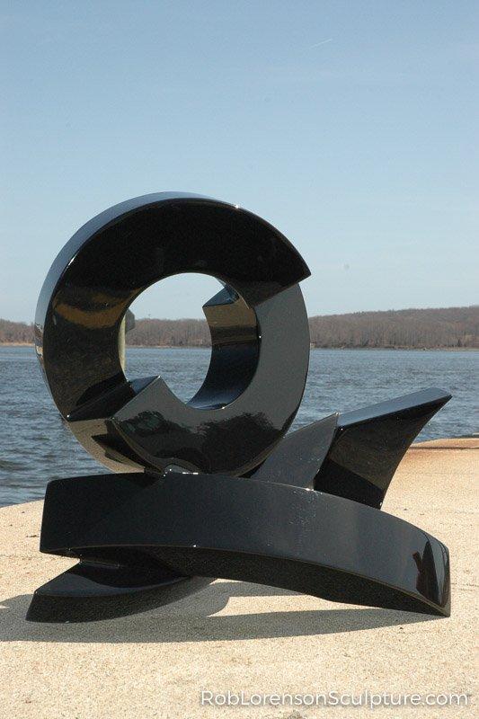 black small outdoor metal sculpture