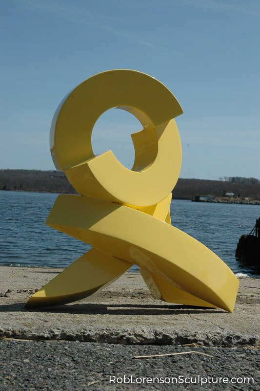yellow small scale outdoor metal sculpture
