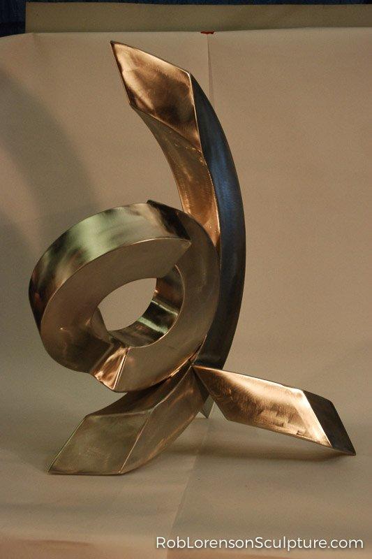 small gold indoor metal sculpture