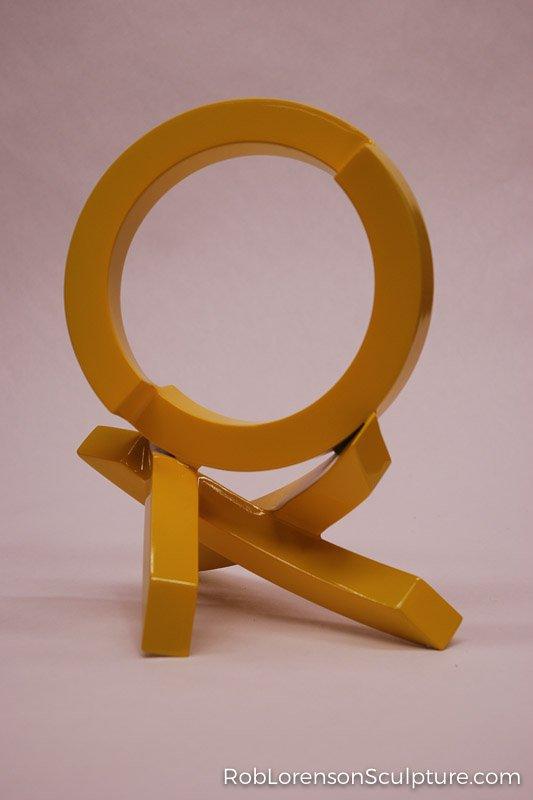 small yellow indoor metal sculpture