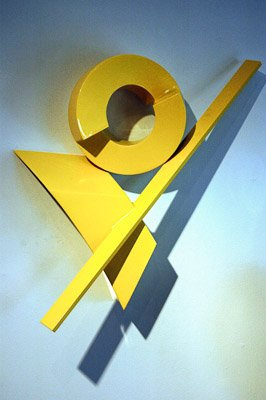 yellow metal wall sculpture
