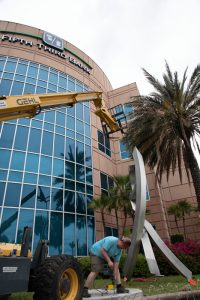 installation of large metal sculpture in Florida